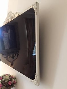 Side view of the Shabby Chic TV. Painted in Annie Sloan Old White, and attached with a hot glue gun. Large pediment can be found here: https://chicmouldings.com/shop/large-ornate-scroll-2 Corners used can be found here: https://chicmouldings.com/shop/shabby-roman-corners-x-4 #EuropeanHomeDecor