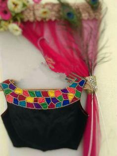 multi colored boat neck on black blouse