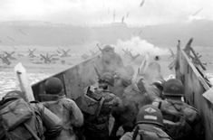 June 6th, 1944 D-Day - Soldiers taking direct hits from a German machine gunner as the ramp drops down for  unloading.