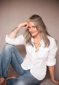 """The model was interviewed, and here's what she says. """"My Uniform: Linen shirts, jeans and silver hoop earrings. In the summer my linen shirts are cream or white. In the winter, they're navy (never black) with brown Varda boots. The jeans are always men's Levis–501s. I hate jeans that are too low cut; they always cause a muffin top! I don't believe in buying worn-out jeans. I like wearing them in myself; they become a part of you, and everyone wears out their jeans differently."""""""