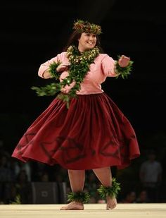This is Lilinoe Sterling from Halau Mohala `Ilima dancing her kahiko set at the 2012 Merrie Monarch hula competition. She was honored as the 2012 Miss Aloha Hula.