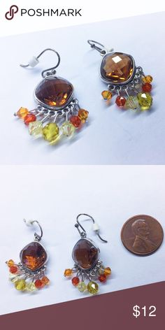 Clear Chocolate earrings w/Green & Orange Tassels Cut glass or beveled brown crystal center piece with green and orange 🍊 dangling beads. Silver colored metal. Jewelry Earrings