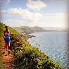 Welcome to #RunnerLand . Photo: @sarah_stirling . Last running in #Wales photo! It was lush to be home in Pembrokeshire for a bit but I'm super excited to be back in #Chamonix ... in the 40 degree heat! .