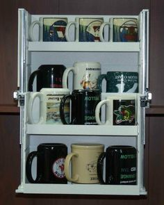 """Mug Organizer by Simplystic Organizers. $111.97. Sturdy construction using ABS plastic (White) for scratch resistant working surfaces and ball bearing slides for smooth gliding action.. [Mugs not included in unit]. Dimensions: 15"""" W x 10.75"""" D x 11.25"""" H; Weight: 12 lbs.. Organizer extends out and downward to showcase and provide access to all mugs and cups. Retracts to a compact size for storage.. Easy installation using high bond strength double sided adhesi..."""