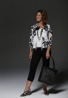 Irene Gavenas models fashion styles for the mature woman. Here, the trend is lace, black and white, capri pants and statement jewelry.