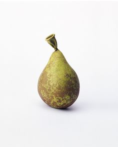 Nancy Fouts' Unexpected Juxtapositions. The british artist creates amazing juxtrapositions that combine unexpected objects, materials, and ideas to create playful and surreal images #fruitart #pear #waterballoon