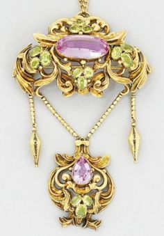 A 19th century gold, topaz and peridot brooch. The scroll design oval openwork panel with central oval pink topaz within four oval-cut peridot three stone clusters, suspending a swag with twin filgree drops and central pear-shaped pink topaz and peridot matching drop, circa 1840.