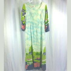 This is an amazing long scenic border print hippie dress with a print of a cloudy blue sky with a border of trees, hills, and flowers. Super fun dress is a soft blend of 50% cotton and 50% Rayon. Dress by JCPenney. The ¾ sleeves also has the border print. Condition: Good vintage condition with some minor flaws. There are a couple of tiny stains, two miniscule stains near the neckline, one tiny one underneath the waistline and a couple small ones on the skirt. These are very small. The only…