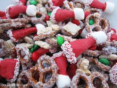 Santa Hat Party Mix  3 cups mini pretzels  1/2 cup craisins  1 cup salted dry roasted peanuts  2 cups Rice Chex  2 cups holiday colored M&M's  8 oz. white chocolate for melting