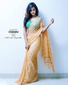 In a sandal color saree, short sleeves blouse design with buti Beautiful Girl Indian, Most Beautiful Indian Actress, Beautiful Saree, Beautiful Dresses, Sarees For Girls, Saree Poses, Saree Photoshoot, Elegant Saree, Saree Look
