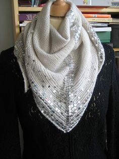 Stunning. This would look great with heathered, silver-grey alpaca yarn and clear iridescent sequins.