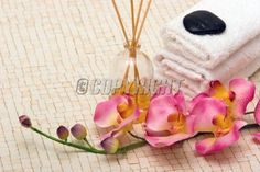 Spa towels, fragrance sticks and pink orchid