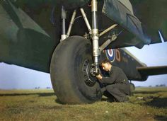 Testing the tyre pressure of Avro Lancaster of No 44 Squadron Conversion Flight at RAF Waddington, Lincolnshire, UK. Aircraft Photos, Ww2 Aircraft, Lancaster Bomber, Battle Of Britain, Royal Air Force, War Machine, British History, Commonwealth, Military History