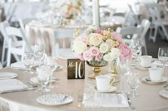 Elegant champagne and blush guest tables and centrepieces with gold mercury glass and wood details. Styling by Satin & Snow, photos by Melanie Rebane.