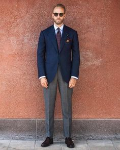 Pair a dark blue sport coat with grey suit pants to ooze class and sophistication. Feeling inventive? Complement your outfit with dark brown leather oxford shoes.   Shop this look on Lookastic: https://lookastic.com/men/looks/blazer-dress-shirt-dress-pants/21182   — Light Blue Dress Shirt  — Burgundy Print Tie  — Burgundy Print Pocket Square  — Navy Blazer  — Grey Dress Pants  — Dark Brown Leather Oxford Shoes