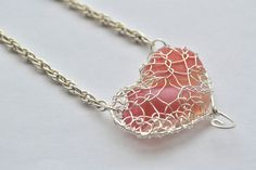 Pink milk Genuine Sea Glass Hand Knitted Fine Silver Wire  Heart Pendant with 16 inch  chain Necklace. $55.00, via Etsy.