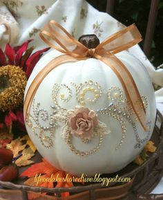 Pumpkin Glitz & Glitter ~ Are you looking for a quick, easy way to give your pumpkins a little glitz? These beautiful crystal appliques used for scrapbooking, a little paint, flower and some ribbon and you have a stunning! pumpkin!