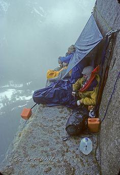 Yosemite, El Capitan. Jay Jensen Doug Robinson (MR) in rainy bivouac halfway up Nose route during February, 1978.