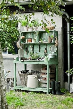 Potting table with crate shelves.