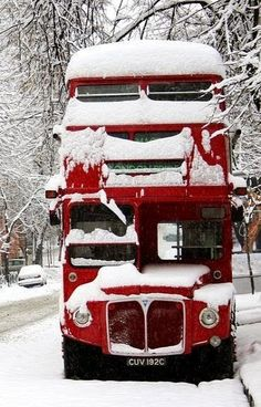 Snow in red double-decker bus, England