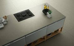 Inalco launches new 12mm thin porcelain countertop in @ 5'x10' format with natural or bush-hammered finish.