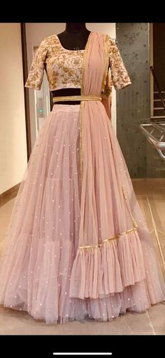 Gorgeous blush pink color layered lehenga and blouse with net dupatta. Lehenga and blouse with floret lata design hand embroidery gold thread work. Indian Wedding Gowns, Party Wear Indian Dresses, Designer Party Wear Dresses, Party Wear Lehenga, Indian Gowns Dresses, Indian Bridal Outfits, Dress Indian Style, Indian Fashion Dresses, Indian Designer Outfits