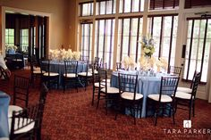 WEDDING DETAILS: centerpiece in creams & blues with silver accents Forest Creek Golf Club Dinning Room