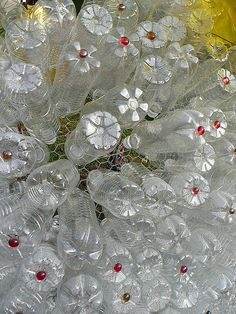 Clear Water Bottles...Pushed through chicken wire, add some beads, paint design or leave plain, can be made round or left flat for flower beds