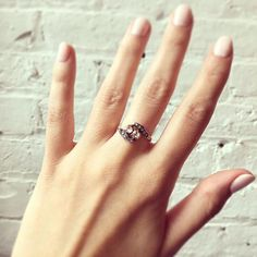 Two-stone engagement rings like this lovely rose cut diamond piece are known as