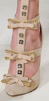 #Chloe uses crystal buttons and shoes.  We've never seen this before!  Awesome!  www.harmanbeads.com
