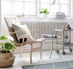 Eva armchair by Bruno Matsson from Bruno Mathsson International and Gräshoppa Table Lamp by Greta Magnusson Grossman from Gubi