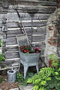 old wash tub planter in the corner of a log cabin