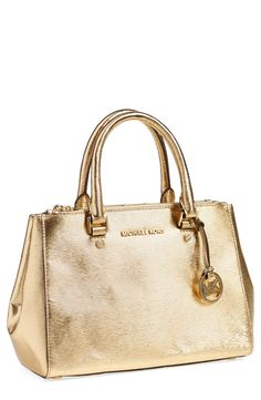 Lusting after this gold bark embossed leather satchel.