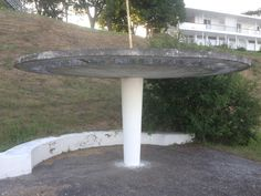 Concrete mushroom shade flower hanger with concrete bench