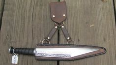Chiseled seax, by Baltimore Knife Sword. The sheath is designed to hang horizontally at the small of the back.