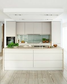 This kitchen would fulfil the practical needs and suit colour requirements and offer a sense of space around it.
