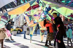 at the foot of new york's flatiron building, SOFTlab has built 'nova', an aluminum pavilion that reflects kaleidoscopic views of the surrounding cityscape.