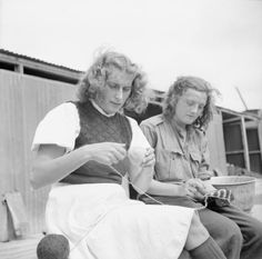 German female prisoners of war knitting in a camp for SS, Luftwaffe and civilian women prisoners at Vilvoorde on the outskirts of Brussels.
