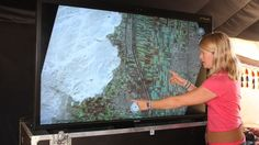 Dr. Sarah Parcak displays satellite imagery revealing ancient Egyptian pyramids, tombs, settlements and other sites.