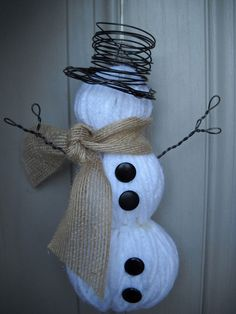 snowman using yarn and foam balls. Love it!