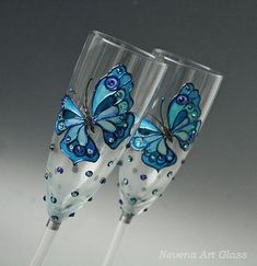 Blue butterfly Wedding Glasses, Champagne Flutes, Butterfly Glasses, Wedding Glasses Set of 2 Hand Painted and decorated champagne glasses. Blue shades butterfly design. Frost effect on the glass surface. Blue crystal rhinestones - polka dot . One of a kind hand painted champagne