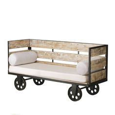 This Factory cart bench comprises of a timber frame on spoked wheels and upholstered seat pad and roll cushions. Not only does the unique sofa capture the industrial vintage 'lived-in' look that is in demand for bar and pub interiors, it is also easy to manoeuvre for greater flexibility.