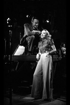 """Randolph Scott & Marlene Dietrich during filming of  """" The Spoilers """" - 1942."""