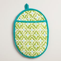 Add a bright pop of color to your kitchen with our green geometric oval potholder, trimmed with turquoise and bursting with springtime style.