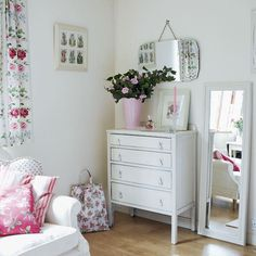 Via Heart Handmade UK blog. Ideas for guest bedroom, white with vintage florals, give old Utility furniture a lick of white paint...already have an old mirror like that.