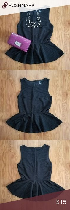 Forever 21 black textured peplum top Sleeveless black peplum top. Textured fabric. Scoop neck. Perfect to wear to the office or for a night out. 96% polyester. Excellent used condition. Forever 21 Tops