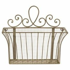"Basket-style metal wall organizer with a scrolling detailed top.  Product: File folder holderConstruction Material: MetalColor: SilverDimensions: 14.5"" H x 16"" W x 3"" D"