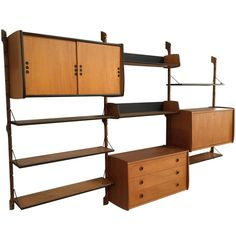 Teak Modular Wall Unit System by Torbjørn Afdal, 1960s | From a unique collection of antique and modern shelves at https://www.1stdibs.com/furniture/storage-case-pieces/shelves/