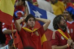 Spain's fans react after they exit the World Cup. Lluis Gene / AFP Photo