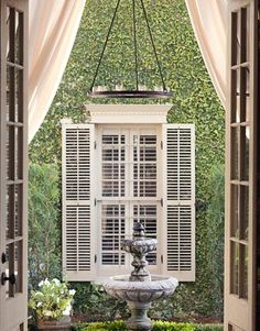 Fig ivy covers the courtyard walls.   - HouseBeautiful.com